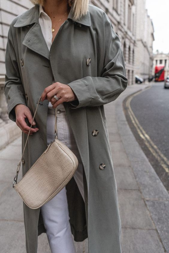 white jeans, a white shirt, a green trench and a neutral reptile leather baguette bag for spring