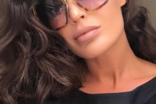 70s styled sunglasses with lavender lenses and a traditional frame but a catchy shape for a statement