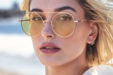 Hailey Baldwin wearing pastel yellow round sunglasses in a gold frame – a fresh take on classics
