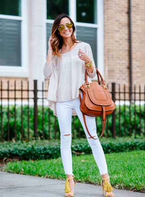 With beige loose shirt, white pants and brown leather bag