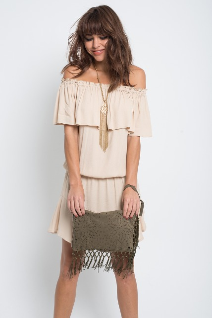 With beige off the shoulder mini dress
