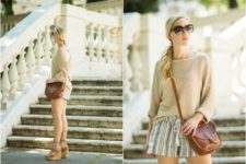 With beige sweatshirt, striped shorts and brown leather bag