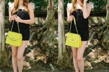 With black hat, black sleeveless romper and yellow bag
