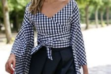 With black hat, straw bag and black midi skirt