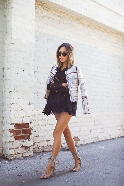 With black lace mini dress, printed jacket and sunglasses