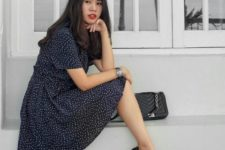 With black leather bag and black flat shoes