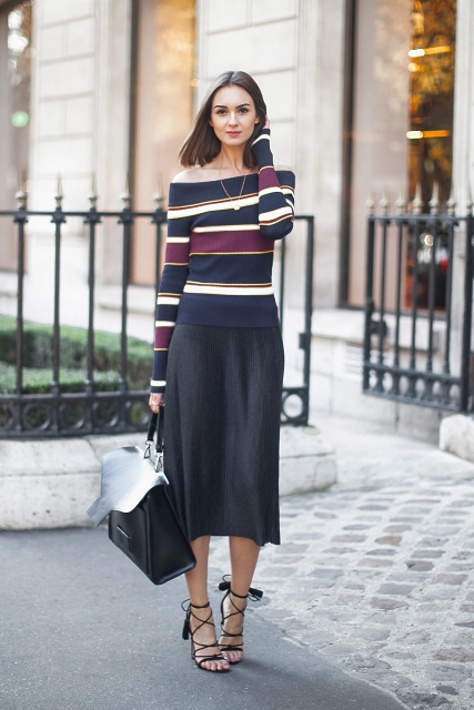With black midi skirt, black leather bag and lace up shoes
