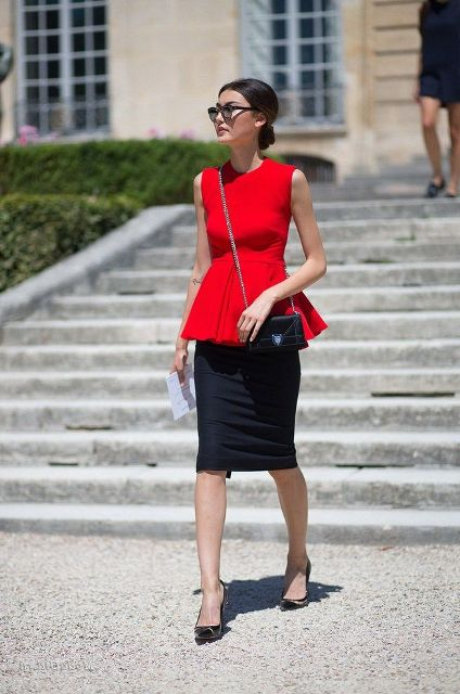 With black pencil skirt, black pumps and chain strap bag