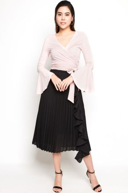 With black pleated midi skirt and black ankle strap high heels
