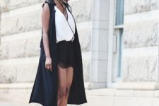 With black shorts, black sleeveless long cardigan and lace up shoes