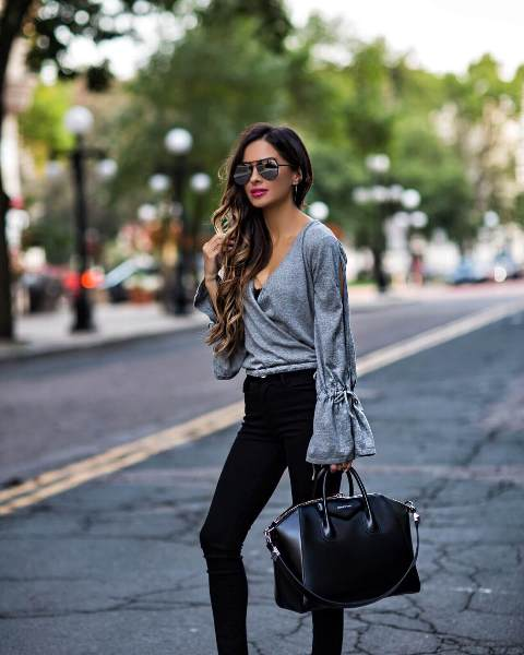 With black skinny pants and black tote bag