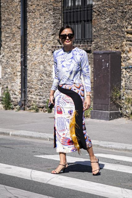 With blue and white printed shirt and printed midi skirt