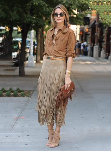 With brown button down shirt, fringe skirt and beige high heels