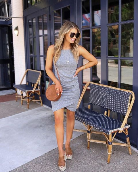 With brown rounded bag and platform sandals