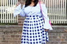 With checked midi skirt, pink bag and bow mules