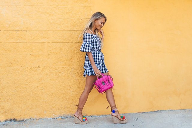 With checked mini dress and pink bag