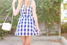 With checked sleeveless dress and white bag