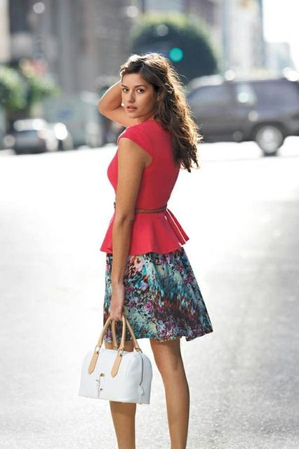 With colorful skirt and white and beige bag