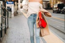 With cropped jeans, red bag and beige pumps