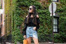 With denim distressed skirt, yellow bag and platform sandals