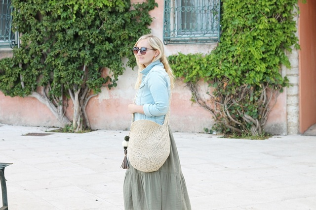 With denim jacket and olive green maxi dress
