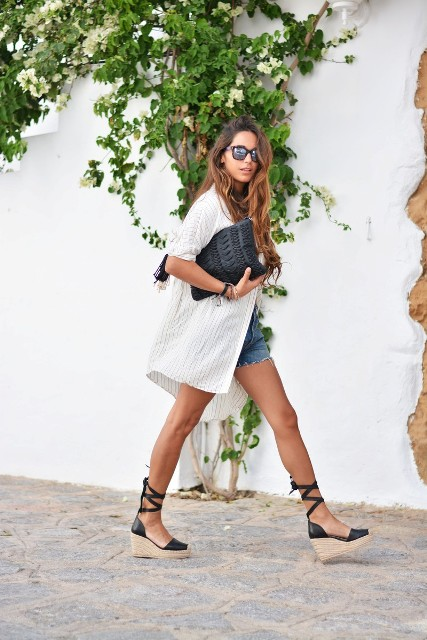 With denim shorts, white long shirt and black clutch