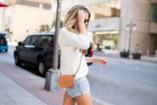 With denim shorts, white shirt and brown mini bag