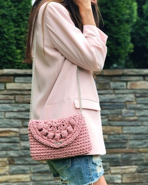 With distressed denim shorts and pale pink blazer