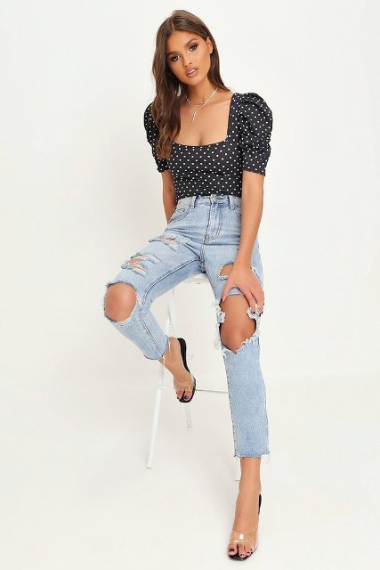 With distressed jeans and transparent shoes