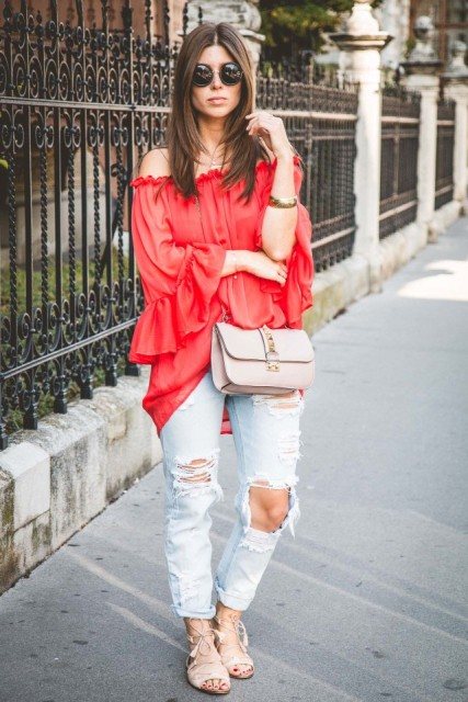 With distressed jeans, beige bag and beige lace up flat sandals