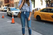 With distressed jeans, beige bag and light blue button down shirt