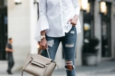 With distressed jeans, gray bag and beige high heels
