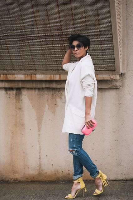 With distressed jeans, pink clutch and white loose blazer