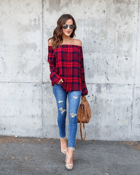 With distressed skinny jeans, white sandals and brown leather bag