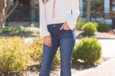 With flare jeans and platform shoes