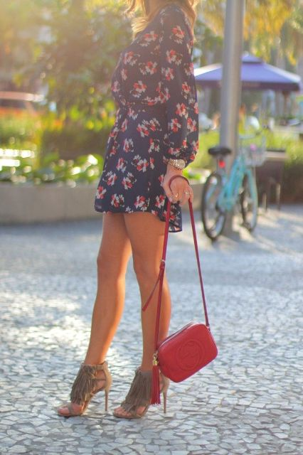 With floral mini dress and red bag