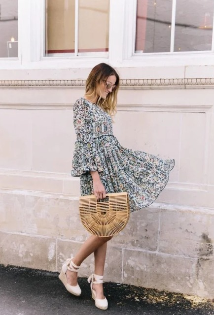 With floral ruffle mini dress and straw bag