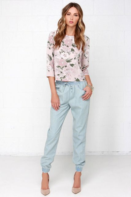 With floral shirt and beige pumps
