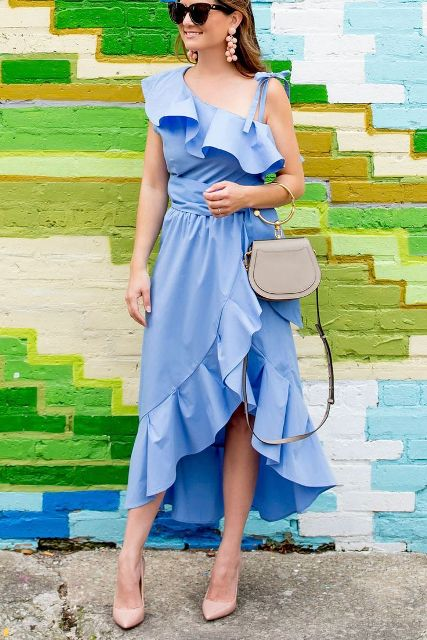 With gray bag and beige pumps
