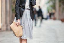 With gray knee-length dress, black blazer and beige clutch