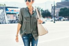 With gray loose shirt, beige bag and super distressed jeans