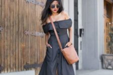 With gray off the shoulder midi dress and brown bag