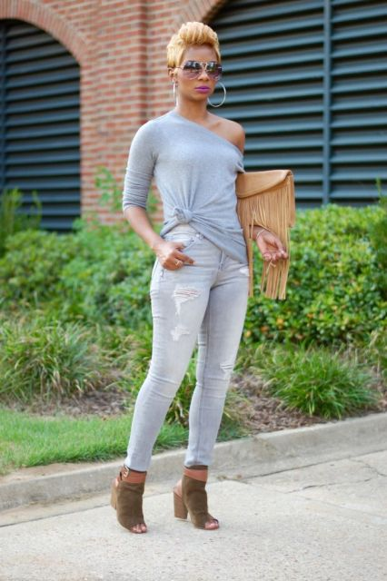 With gray one shoulder shirt, distressed jeans and olive green cutout shoes