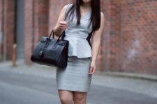 With gray skirt, black bag and black low heeled shoes