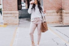 With gray sweatshirt, brown tote bag, cap and flat sandals