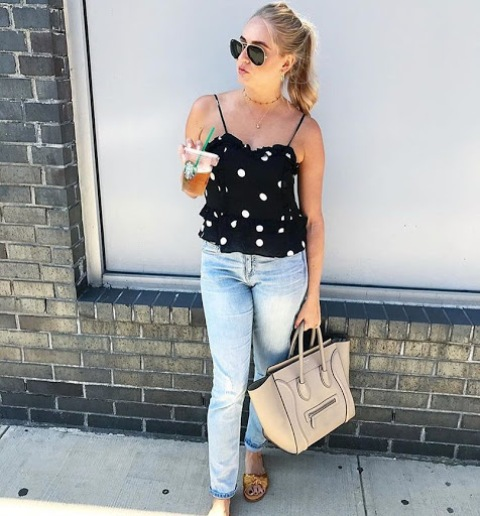 With jeans, beige bag and yellow sandals