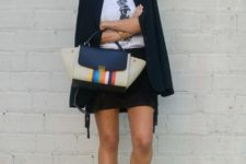 With labeled t-shirt, black mini skirt, navy blue blazer and colorful bag