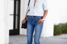 With light blue button down shirt, chain strap bag and skinny jeans