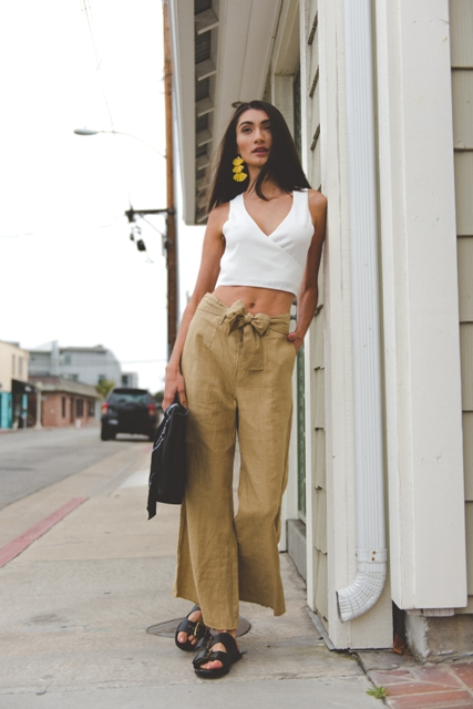 With linen pants, black bag and black flat sandals