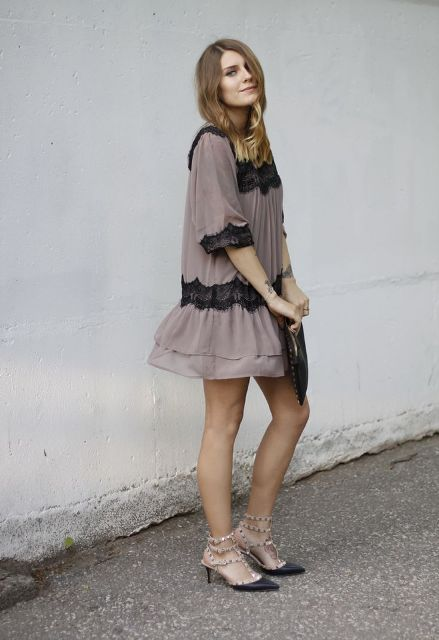 With loose mini dress and black clutch